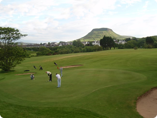 Playing golf at Cushendall Golf Club